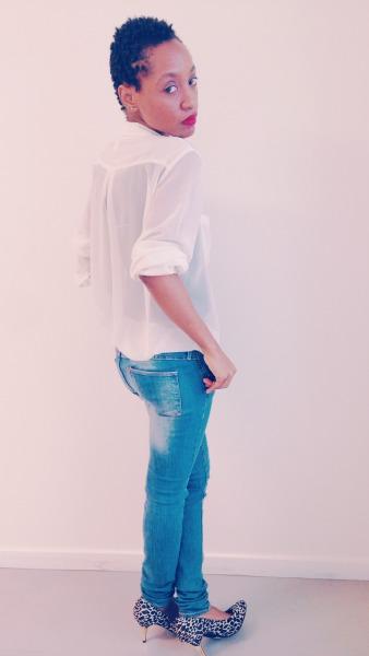 white top blue jeans animal print heels